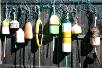 Lobster Bouys hung on fence